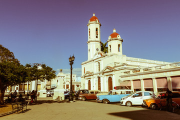 Vintage cars parked in the Jose Marti Park, in front of the Purisima Concepcion Cathedral. Cienfuegos, Cuba.