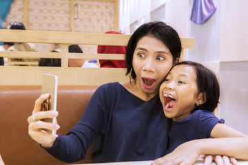 Mother and child taking funny selfie