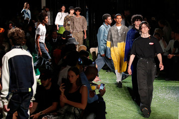 Models present creations by designer Virgil Abloh as part of his Spring/Summer 2019 collection for Off-white fashion label during Mens' Fashion Week in Paris