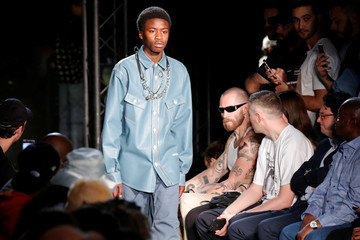 A model presents a creation by designer Virgil Abloh as part of his Spring/Summer 2019 collection for Off-white fashion label during Mens' Fashion Week in Paris