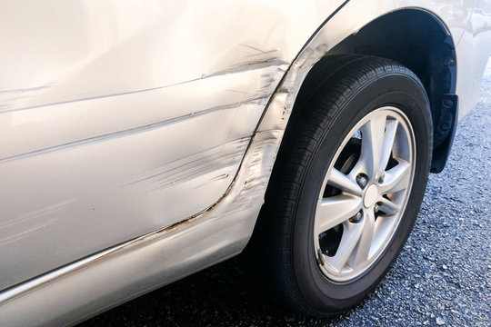 Car with minor dent and scratch due to accident