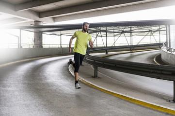 Man running in parking garage in a curve