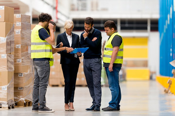 Workers with supervisors at warehouse