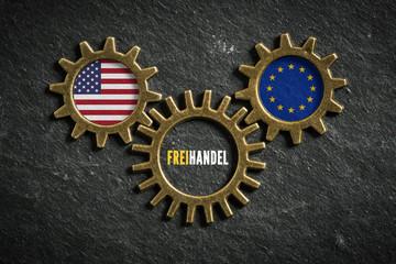Zahnräder auf Schiefertafel symbolisieren Freihandel zwischen USA und EU