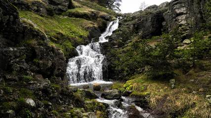waterfall flowing from the mountain