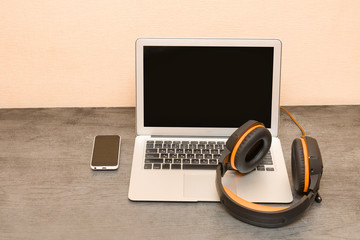 Laptop, headphones and smart phone. Workplace