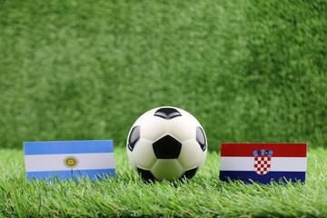 ball with Argentina VS Croatian flag match on Green grass football 2018