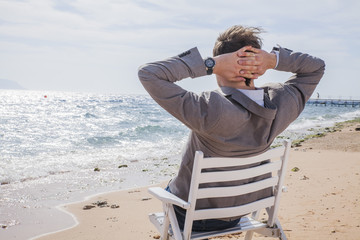 businessman on the beach by the sea