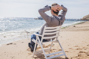 businessman on the beach by the sea