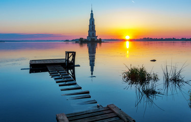 Flooded bell tower of St. Nicholas Cathedral in Kalyazin Kalyazin at sunrise, Tver region, Russia