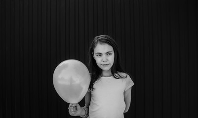 girl holding a balloon black and white photo