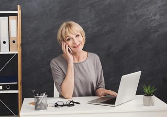 Successful mature entrepreneur talking on phone