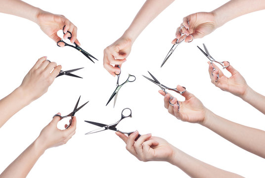 Hairdresser holding scissors in hand isolated on white background