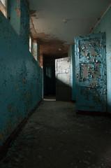 abandoned old german psychiatry hospital empty hallway broken windows and walls - scary haunted asylum old house