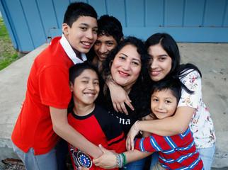 Morena Vasquez with her children Jerry Espinoza, 13, (L) Kevyn Rodriguez, 8, Brian Vasquez, 16, Leslie Vasquez, Isai Rodriguez, 5, in Rome, Georgia