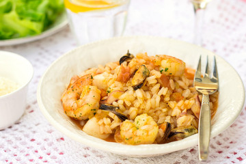 Italian rice dish risotto with seafood, shrimps and mussels
