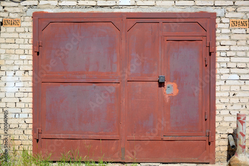 Red Garage Doors With Old Paint