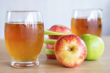 fresh green and red apple fruit and juice glasses , healthy drink for weight control in summer