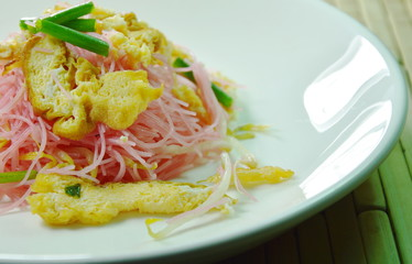 stir fried vermicelli with coconut milk topping slice egg on plate