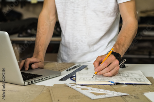 consumer accessories or bags designer at work in workshop hands of
