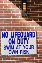 no lifeguard on duty swim at your own risk sign