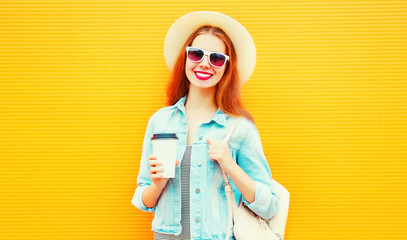 Happy cool girl with a coffee cup on a orange background