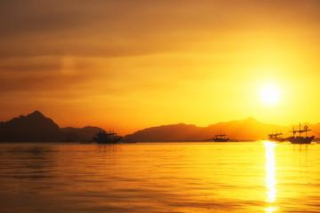 Sunset at the sea. Philippine boats at sea, Boracay, El Nido, Philippines