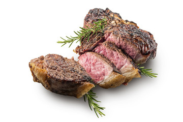 Deurstickers Steakhouse Sliced T-bone steak with rosemary