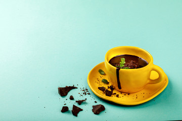 Hot Chocolate with Green Mint in Yellow Cup Drink Dessert on Colorful Background Copy space for Tex