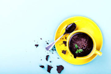 Hot Chocolate with Green Mint in Yellow Cup Drink Dessert on Colorful Background  Top View Copy space for Text Flat Lay