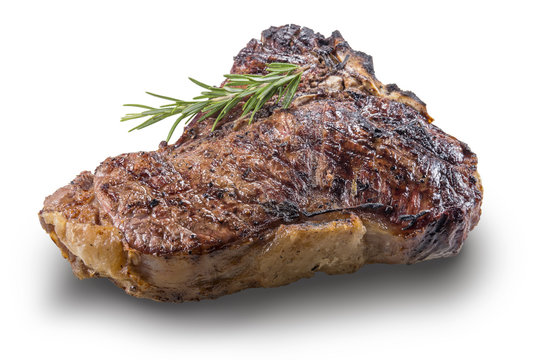 Whole grilled T-bone steak with rosemary