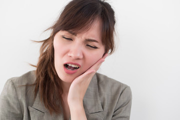 woman with toothache; sick asian woman suffering from toothache, tooth decay, tooth sensitivity, cavity, dental care concept; young adult asian woman model