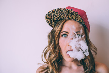 Skater woman smoking a cannabis joint