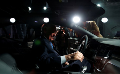 South Carolina Governor Henry McMaster looks over the interior of the Volvo S60 during the inauguration of Volvo Cars first U.S. production plant in Ridgeville