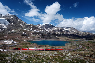 A red train in high mountains