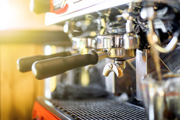 Close up professional coffee machine making espresso in a cafe