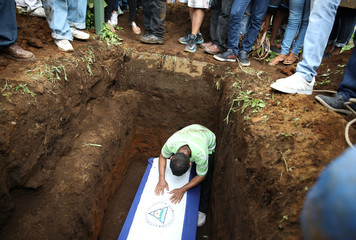 Friends and family members of Marvin Lopez, who was killed during a protest, mourn during his funeral, in Masaya