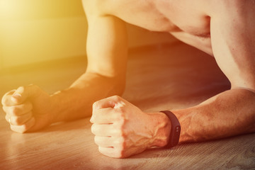man with fitness tracker doing plank exercise, healthy lifestyle concept