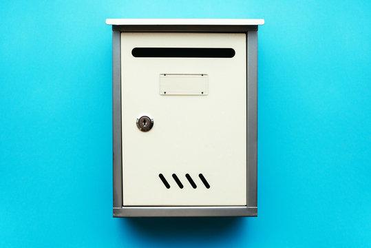 Metal mailbox on blue wall