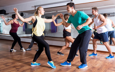 People learning swing at dance class