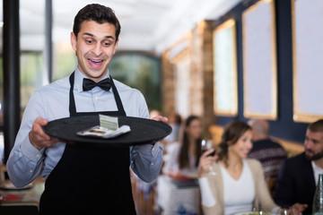 waiter man holding serving tray