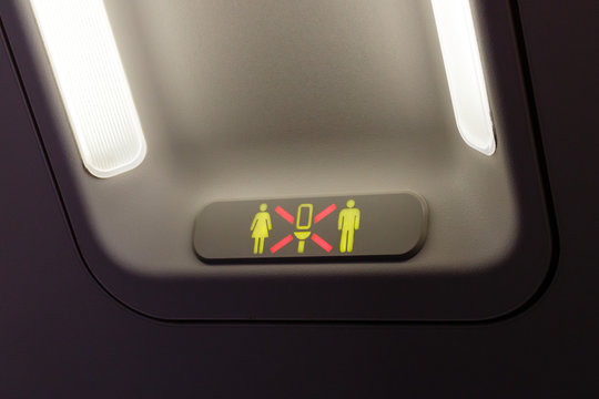 Occupied lavatory sign on the commercial airlines.