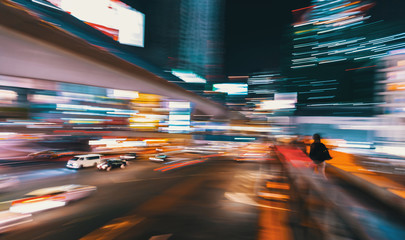 Abstract blurred view of people and traffic crossing a busy intersection in Shibuya, Tokyo, Japan Fotomurales