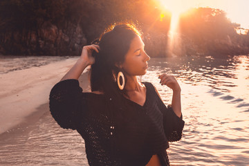 beautiful young woman model on the beach at sunset
