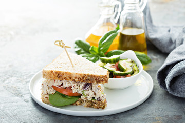 Chicken salad sandwich with spinach and tomato
