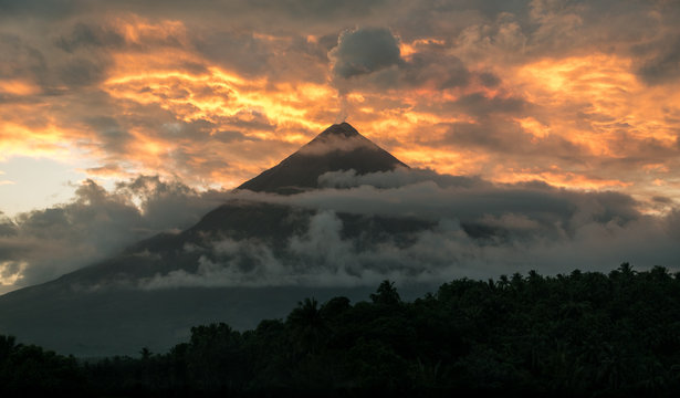 Mt. Mayon Volcano Shooting a Plume of Smoke at Sunset - Albay, Philippines