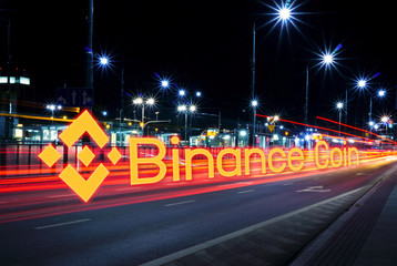 Concept of Binance  coin  moving fast  on the road, a Cryptocurrency blockchain platform , Digital money