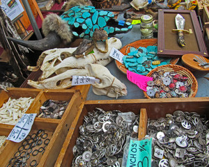 Flea Market in Texas.  Traditional souvenirs in western Texas and Mexican vintage style - decorative metal things, jewelry made of turquoise stones, skulls with horns and a knife.