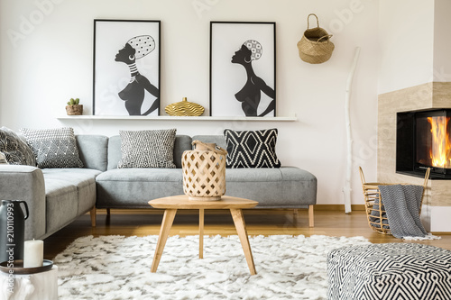 Wooden Table On Carpet In African Living Room Interior With