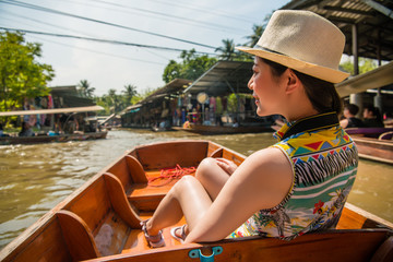 Woman looking forward the view of floating market